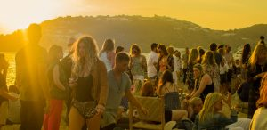 Festival crowd at sunset
